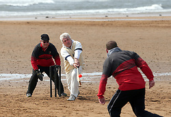 Action from the beach cricket match in Elie, between the Ship Inn cricket team, in Elie, Fife and Eccentric Flamingos CC.  The Ship Inn are the only pub in Britain to have a cricket team with a pitch on the beach. The Ship Inn CC season runs from May to September with dates of matches dependent on the tide. They play against a combination of regular opposition from Scotland and touring teams from all over the world. Any Batsman hitting a six which lands in the Ship Inn beer garden wins their height in beer and any non playing spectator who catches a six in the beer garden also wins their height in beer.PRESS ASSOCIATION Photo. Picture date:Sunday April 30, 2017. Photo credit should read: Andrew Milligan/PA Wire.