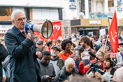 © Licensed to London News Pictures. 04/10/2018. London, UK. Labour Shadow Chancellor John McDonnell MP speaks to striking fast food workers at a rally in Leicester Square as part of strike action over pay. UberEats, JD Wetherspoon, McDonald's and TGI Fridays workers are among those taking part. Photo credit: Rob Pinney/LNP