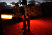 A young couple talks under the glow of a street light. Biologically, women's risk of acquiring sexually transmitted infections during unprotected sexual relations is two to four times that of men. Younger women are at greater risk because their reproductive tracts are still maturing.