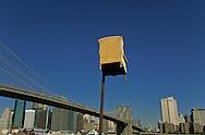 New York. Art festival. Armchair under the brooklyn bridge. sculpture exhibition in Fulton ferry park , under the Brooklyn bridge DUMBO area, New York  Usa   /   fauteuil sous le pont de brooklyn. exposition de sculptures, le Fulton ferry park,  sous le pont de Brooklyn Dumbo  New York  USa