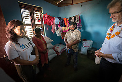 17 September 2018, Kavre district, Nepal: Rev. Joseph Soren from Nepal Evangelical Lutheran Church (right) leads a moment of prayer at the end of a visit to Binala Tolange's (left) home in Biruwa. Tolange is a Christian, seventh adventist Dalit who has rebuilt her house after the 2015 earthquake with support from the LWF. The Lutheran World Federation World Service programme reaches communities far into the rural areas of Nepal. In the Kavre district, the programme runs a Post-Earthquake Rehabilitation and Livelihood Recovery Project.