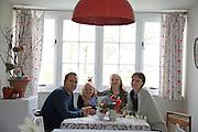 The Elliott family in their dining room. From left to right: Richard Elliott, Milly-grace (8), Molly Elliott (10), Tracey Elliott. Pickwell Manor, Georgeham, North Devon, UK.<br /> CREDIT: Vanessa Berberian for The Wall Street Journal<br /> HOUSESHARE