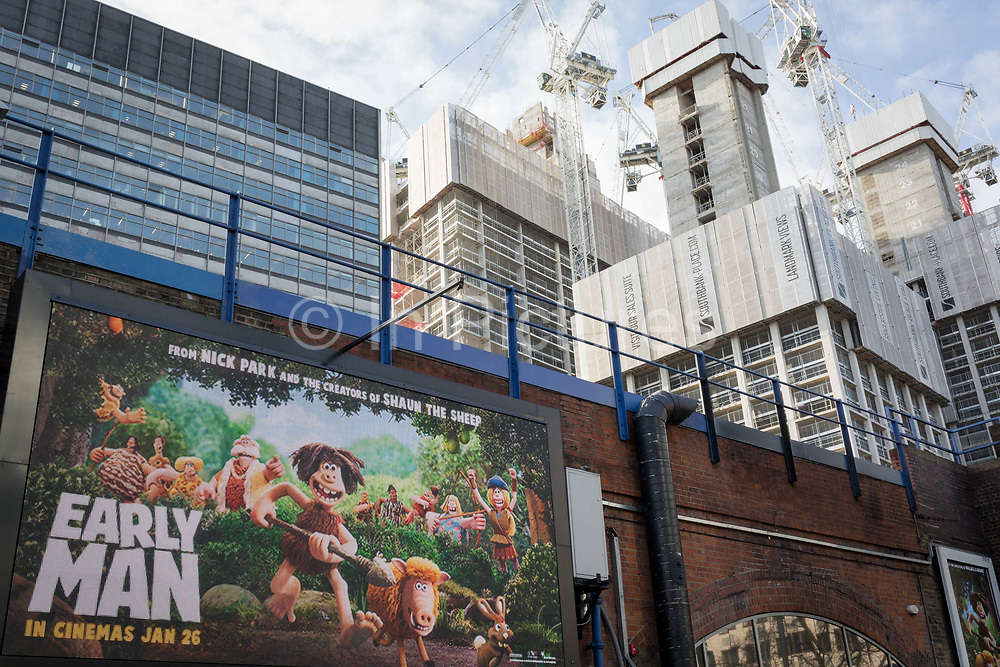 High-rise towers on the Southbank and an ad for the new Aardman Animations new release Early Man, on 30th January 2018, in the south London borough of Southwark, England.