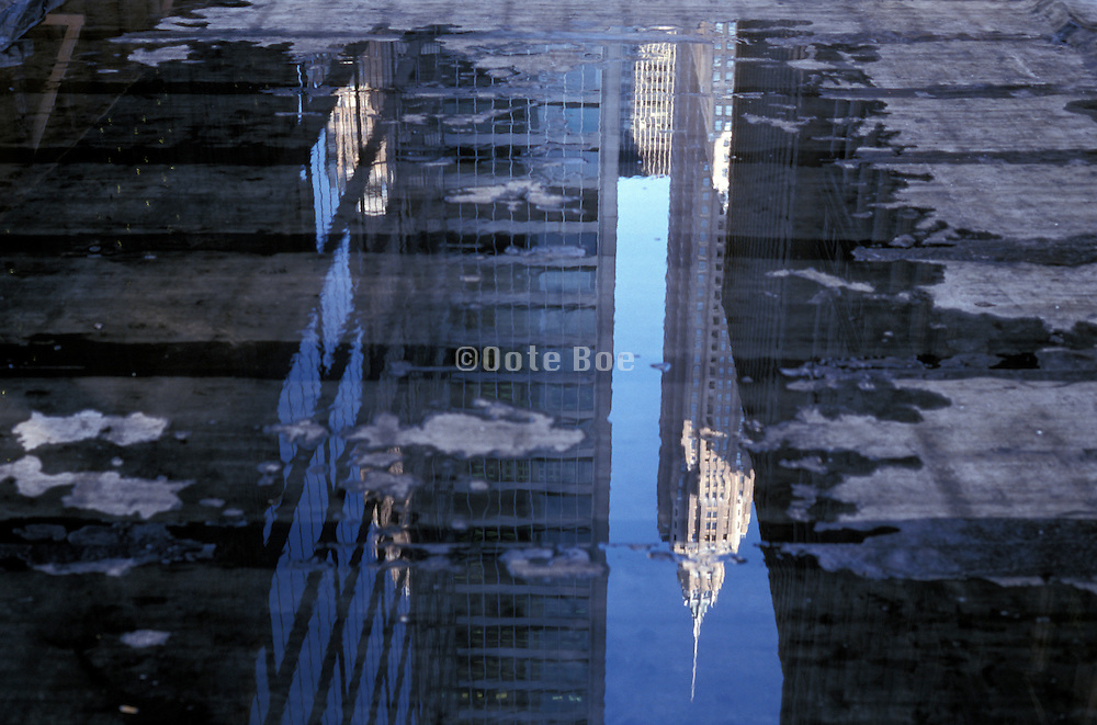 abstract reflection of office buildings in water