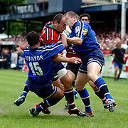 L-R; Sale Shark's Jason Robinson tackle's Gloucester's Ludovic Mercier with help from teammate Mark Cueto