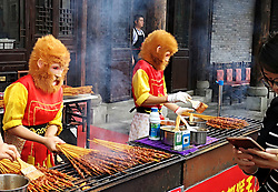 October 8, 2018 - Chongqing, Chongqing, China - Chongqing, CHINA-Two men wearing the costume of 'Monkey King' sells barbecued Shish Kebab at a scenic area in southwest China's Chongqing. (Credit Image: © SIPA Asia via ZUMA Wire)
