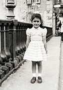 little girl posing France ca 1960s