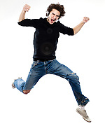 studio portrait of one  caucasian young man listening to music music jumping screaming isolated on white background