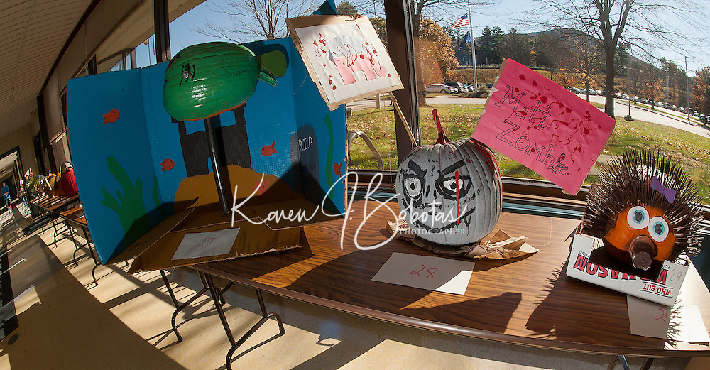 Frankenfish, Mitt Zombie and a wide eyed porcupine are a few of the 48 dressed up pumpkins lining the front hallway of Gilford High School waiting to be judged in the coming week.  (Karen Bobotas/for the Laconia Daily Sun)