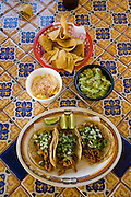 A typical Mexican dish of tacos and guacamole is served at Lourdes Alvarez's Mexican Restaurant El Coyote in Alsip, Chicago, Illinois.  (Lourdes Alvarez is featured in the book What I Eat;  Around the World in 80 Diets.)