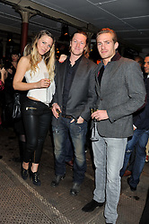 Left to right, SOPHIE MOSS, ARTHUR LANDON and JACOBI ANSTRUTHER-GOUGH-CALTHORPE at a party to celebrate the launch of the new Vertu Constellation phone - the luxury phonemakers first touchscreen handset, held at the Farmiloe Building, St.John Street, Clarkenwell, London on 24th November 2011.