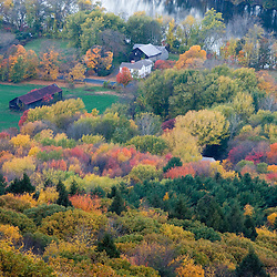 Farm in forest in fall next to the Connecticut River in Hadley, Massachusetts.