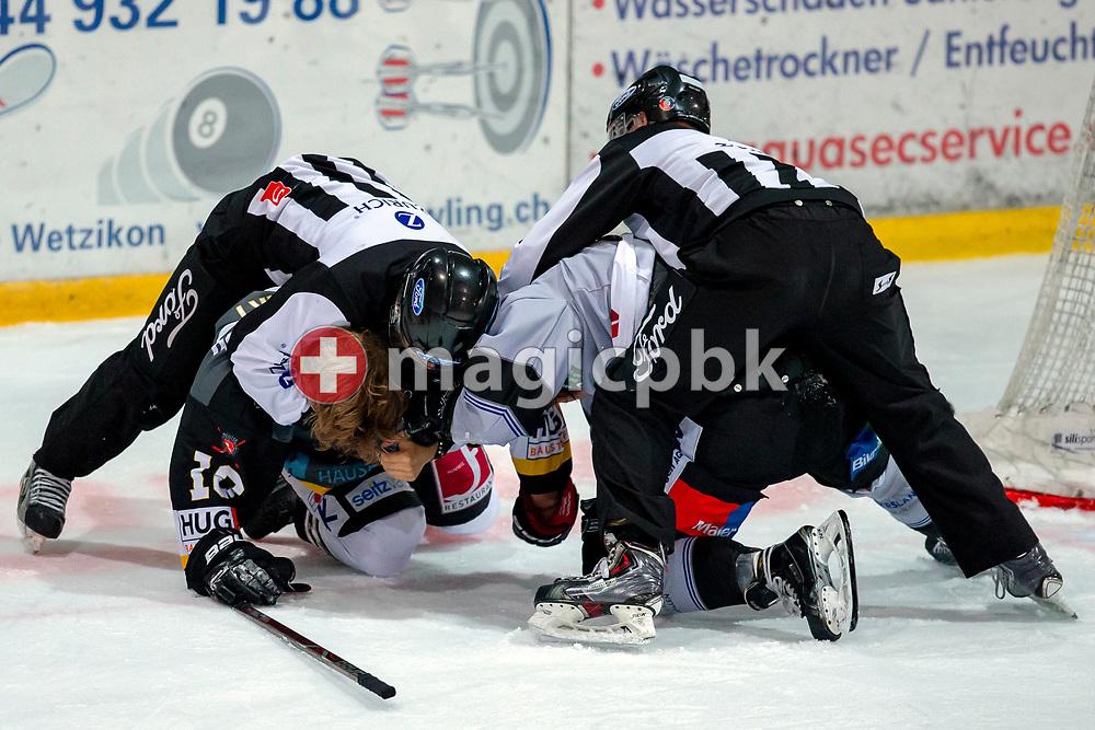 EHC Wetzikon forward Adrian Rykart (L) is fighting with PIKES EHC Oberthurgau forward Nils Seiler during a Swiss 1st League ice hockey game (Season 2018/2019) between EHC Wetzikon and PIKES EHC Oberthurgau in Wetzikon, Switzerland, Saturday, Oct. 6, 2018. (Photo by Patrick B. Kraemer / MAGICPBK)