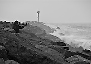 Photographer Taking Pictures at the Wedge in Newport Beach