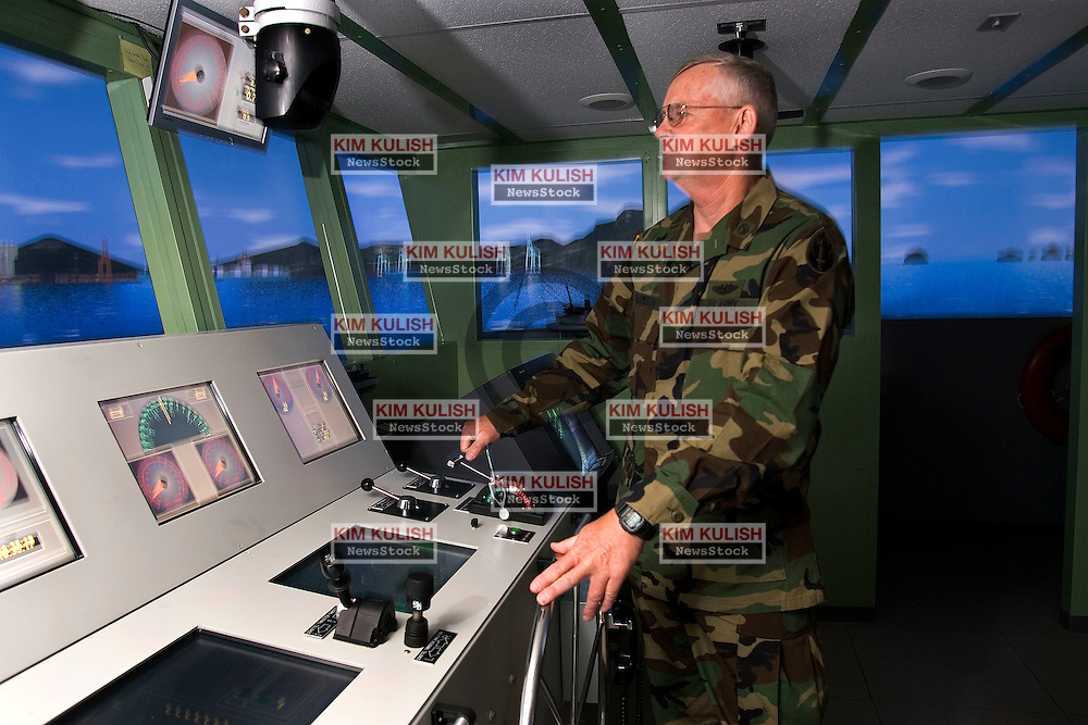 """Chief Warrant Officer CW4 Robert Blomerth demonstrates and describes the benefits of the new Maritime Integrated Training Simulator opened June 11, 2005 on Mare Island in Vallejo, Calif.  The new virtual training facility replicates 32 different vessels so crews can train in real-time multi-ship scenarios, at various ports and weather conditions.  The """"Virtual Ship"""" facilities are built and supported by CSC, Computer Sciences Corporaton, in Washington, D.C. Photo by Kim Kulish"""
