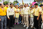 05 MAY 2104 - BANGKOK, THAILAND:  SUTHEP THAUGSUBAN (right center) leads a march of anti-government protesters to Sanam Luang in Bangkok. Thousands of Thais packed the area around Sanam Luang and the Grand Palace Monday evening for a special ceremony to mark Coronation Day, which honored the 64th anniversary of the coronation of Bhumibol Adulyadej, the King of Thailand. Many of the people also support the anti-government movement led by Suthep Thaugsuban. Most of the anti-government protesters are conservative supporters of the monarchy.   PHOTO BY JACK KURTZ