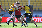 Crusaders Will Jordan is tackled in the Super Rugby match, Hurricanes v Crusaders, Sky Stadium, Wellington, Sunday, April 11, 2021. Copyright photo: Kerry Marshall / www.photosport.nz