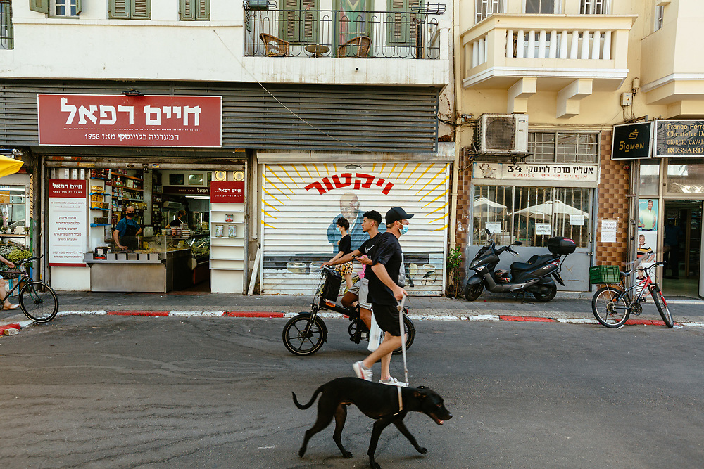 People are seen enjoying a hot summer afternoon at Levinsky Street, a pedestrian zone in the Levinsky Market area in southern Tel Aviv, Israel, on August 19, 2020. A ban on vehicles in Levinsky Street was started at the end of 2019, as a pilot of a new municipality initiative to reduce the number of private cars in the inner city.<br /> The Tel Aviv-Jaffa  Municipality is planning to convert 11 popular streets in the city, into pedestrian zones shut to vehicles in the coming months.