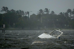 September 10, 2017 - Florida, U.S. - A boat is partially submerged in choppy waters in the Intracoastal Waterway near Bryant Park in Lake Worth Sunday, September 10, 2017. (Credit Image: © Bruce R. Bennett/The Palm Beach Post via ZUMA Wire)