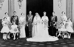 The wedding of Prince Henry, Duke of Gloucester to Lady Alice Christabel Montagu-Douglas-Scott at the private chapel at Buckingham Palace. Left to right: Clare Phipps, The Duke of York (later George VI), Lady Elizabeth Scott, the Duke of Gloucester and his bride Lady Alice Scott, Lady Angela Scott, The Prince of Wales (later Edward VIII), and Moyra Scott. Left to right front row: Lady Mary Cambridge, Princess Elizabeth (now Queen Elizabeth II, Princess Margaret and Anne Hawkins.