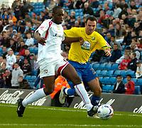 Photo: Ed Godden.<br /> Milton Keynes Dons v Hereford United. Coca Cola Championship. 21/10/2006. MK Dons' Leon Crooks (L) keeps Alex Jeannin off the ball.