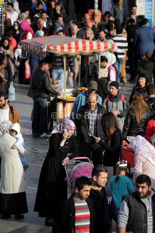 street scene with crowd and street vendor Istanbul Turkey