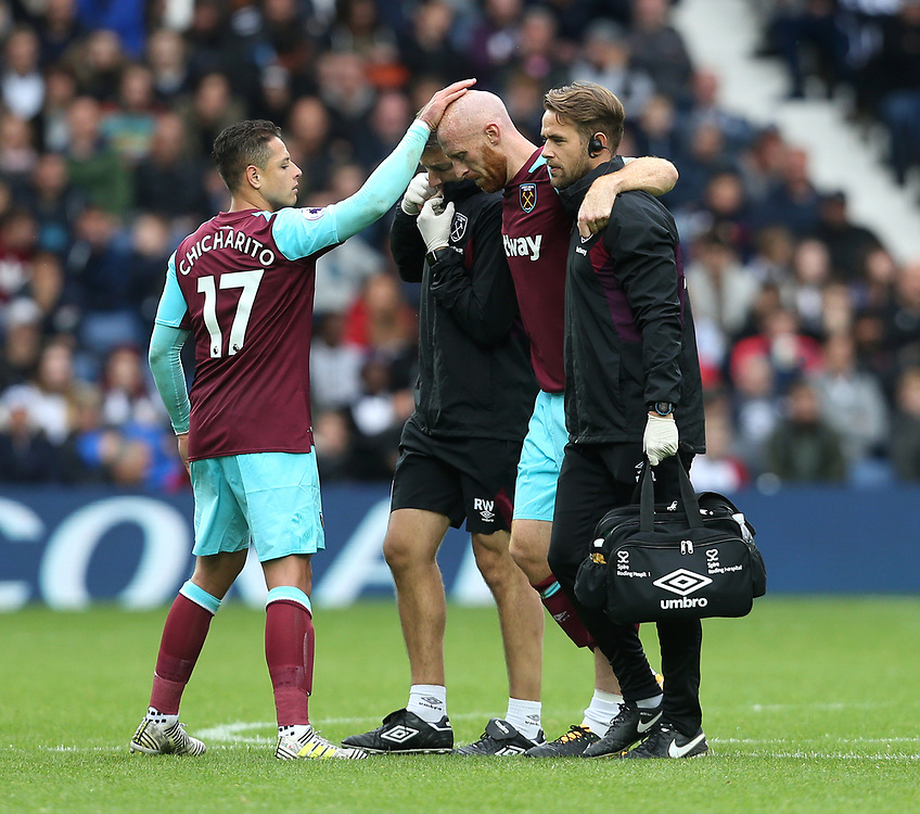 West Ham United's James Collins gets a pat from Javier Hernandez as he walks off injured<br /> <br /> Photographer Rob Newell/CameraSport<br /> <br /> The Premier League - West Bromwich Albion v West Ham United - Saturday 16th September 2017 - The Hawthorns - West Bromwich<br /> <br /> World Copyright © 2017 CameraSport. All rights reserved. 43 Linden Ave. Countesthorpe. Leicester. England. LE8 5PG - Tel: +44 (0) 116 277 4147 - admin@camerasport.com - www.camerasport.com