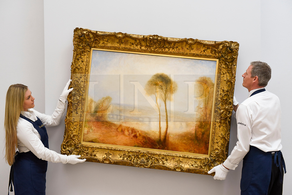 "© Licensed to London News Pictures. 28/06/2019. LONDON, UK. Technicians hang ""Landscape with Walton Bridges"" by J.M.W. Turner (Est. GBP4-6m) at the preview of Sotheby's Old Masters sale which takes place at its New Bond Street galleries on 3 July.  Photo credit: Stephen Chung/LNP"