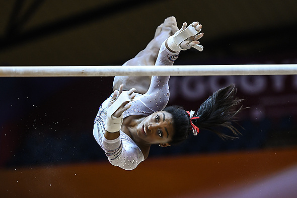 October 23, 2018 - Doha, Qatar - SIMONE BILES practices on the uneven bars during the first day of podium training before the competition held at the Aspire Dome in Doha, Qatar. (Credit Image: © Amy Sanderson/ZUMA Wire)