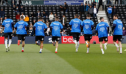 Derby County players warm up in Mind charity strips
