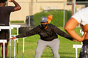 Defensive backs, Safeties, and kicking skills Coach Desireé Allen leads a drill during North Dallas Bulldogs HS football team on the first day of practice since the onset of the Covid-19 pandemic.She is the only female coach on staff.  (Photo by Jaime R. Carrero)