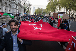 London, UK. 11th May, 2021. Demonstrators march in Parliament Street with a huge Turkish flag as thousands of people attend an emergency rally in solidarity with the Palestinian people organised by Palestine Solidarity Campaign, Friends of Al Aqsa, Stop The War Coalition and Palestinian Forum in Britain. The rally took place in protest against Israeli air raids on Gaza, the deployment of Israeli forces against worshippers at the Al-Aqsa mosque during Ramadan and attempts to forcibly displace Palestinian families from the Sheikh Jarrah neighbourhood of East Jerusalem.