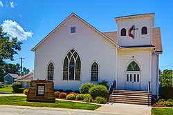 31 July 2015:   A white framed church with arched stained glass windows, doorway and a belfry is occupied by the Ellsworth United Methodist church in Ellsworth Illinois<br /> <br /> <br /> This image was produced in part utilizing High Dynamic Range (HDR) processes.  It should not be used editorially without being listed as an illustration or with a disclaimer.  It may or may not be an accurate representation of the scene as originally photographed and the finished image is the creation of the photographer.