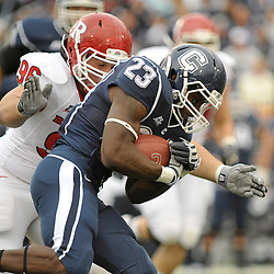 Oct 31, 2009; East Hartford, CT, USA; Rutgers defensive tackle Charlie Noonan (96) tackles Connecticut running back Jordan Todman (23) during first half Big East NCAA football action between Rutgers and Connecticut at Rentschler Field.