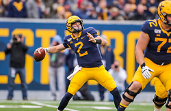 Nov 23, 2019; Morgantown, WV, USA; West Virginia Mountaineers quarterback Jarret Doege (2) throws a pass during the third quarter against the Oklahoma State Cowboys at Mountaineer Field at Milan Puskar Stadium. Mandatory Credit: Ben Queen-USA TODAY Sports