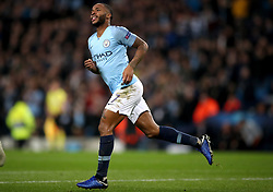 Manchester City's Raheem Sterling celebrates scoring his side's third goal of the game