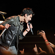 """The Jonas Brothers perform a free concert at the Warner Theater in Washington, D.C.  for their fans in conjunction with Live Nation, who announced a speacial """"No Ticket Fee"""" promotion for June 2010 ."""