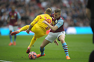 Alberto Moreno of Liverpool is challenged by Tom Cleverley of Aston Villa . The FA Cup, semi final match, Aston Villa v Liverpool at Wembley Stadium in London on Sunday 19th April 2015.<br /> pic by John Patrick Fletcher, Andrew Orchard sports photography.