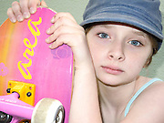 An agglo-german girl holds her skateboard. Karlsruhe, Germany, 27 May 2013. © Guy Bell Photography, GBPhotos