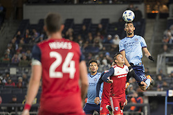 April 29, 2018 - Bronx, New York, United States - New York City midfielder YANGEL HERRERA (30) heads the ball over FC Dallas midfielder MAURO DIAZ (10) while FC Dallas defender MATT HEDGES (24) looks on during a regular season match at Yankee Stadium in Bronx, NY.  NYCFC defeats FC Dallas 3 to 1. (Credit Image: © Mark Smith via ZUMA Wire)