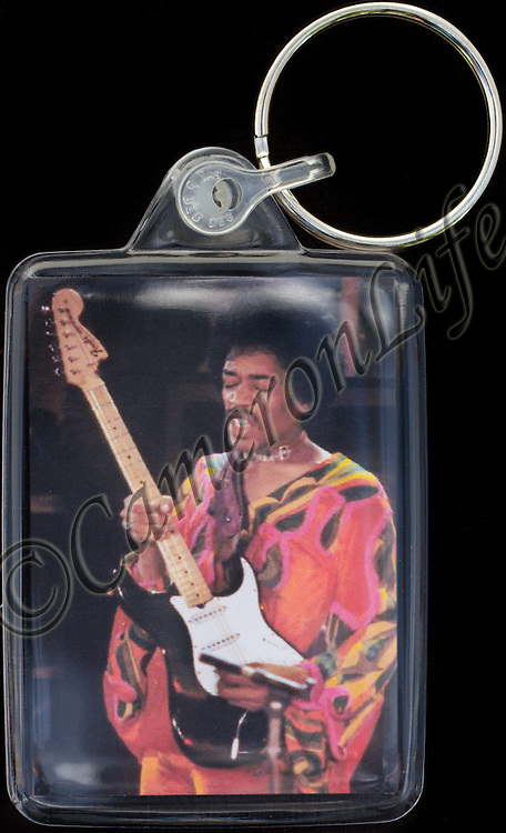 Jimi Hendrix - Key Fob with image approx. 35mm x 50mm from 1970 Isle of Wight Music Festival exhibition on the front. The reverse has an exclusive CameronLife  1970 IW festival design