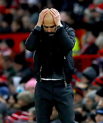 Manchester City manager Pep Guardiola reacts during the Premier League match at Old Trafford, Manchester.