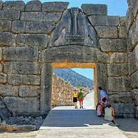 Mycenae. Peloponnese. Greece. View of the monumental Lion Gate, the entrance to the citadel of Mycanae. The gate, built in 1250 BC, is named after the two lions carved into the triangular slab of grey limestone above the lintel. Mycenae, home to King Agamemnon and stated by Homer as 'Rich in Gold' and 'Well built 'was the capital of the Bronze-Age Mycenaean civilisation which dominated Greece from 1500 to 1200 BC.