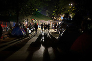 Activists walk through their tents at Gezi Park in Taksim Square Istanbul, Turkey, in the early hours of 10 June 2013. Turkey's crackdown on opposition protesters that reports said left at least two dead and more than 1,000 injured was 'truly disgraceful,' Amnesty International said 02 June, on a third day of the demonstrations. Demonstrations against the Islamic-conservative government of Prime Minister Recep Tayyip Erdogan began on 31 May when a police crackdown against a peaceful sit-in staged by environmentalists angered over a development project in Istanbul escalated into larger battles between law enforcement and demonstrators.