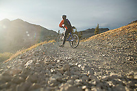 Young man mountain biking in the Sierra Nevada Mountains. Lake Tahoe, CA