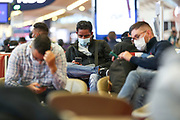 People wearing surgical face protective masks to curb the spread of Coronavirus pandemic outbreak, wait for their flights in Terminal E2 at the Charles de Gaulle Airport in Paris, on Saturday, Dec 12, 2020.<br /> <br /> France recorded about 2,351,372 coronavirus infections, with 57,567<br /> of them resulting in death and 175,891 of them recovered. (VXP Photo/ Vudi Xhymshiti)