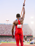 SYDNEY -  SEPTEMBER 28:  Raul Duany #1468 of Cuba throws the javelin during the Men's Decathlon event of the 2000 Olympic Games track and field competition on September 28, 2000 at the Olympic Stadium in Sydney, Australia.  (Photo by David Madison/Getty Images)