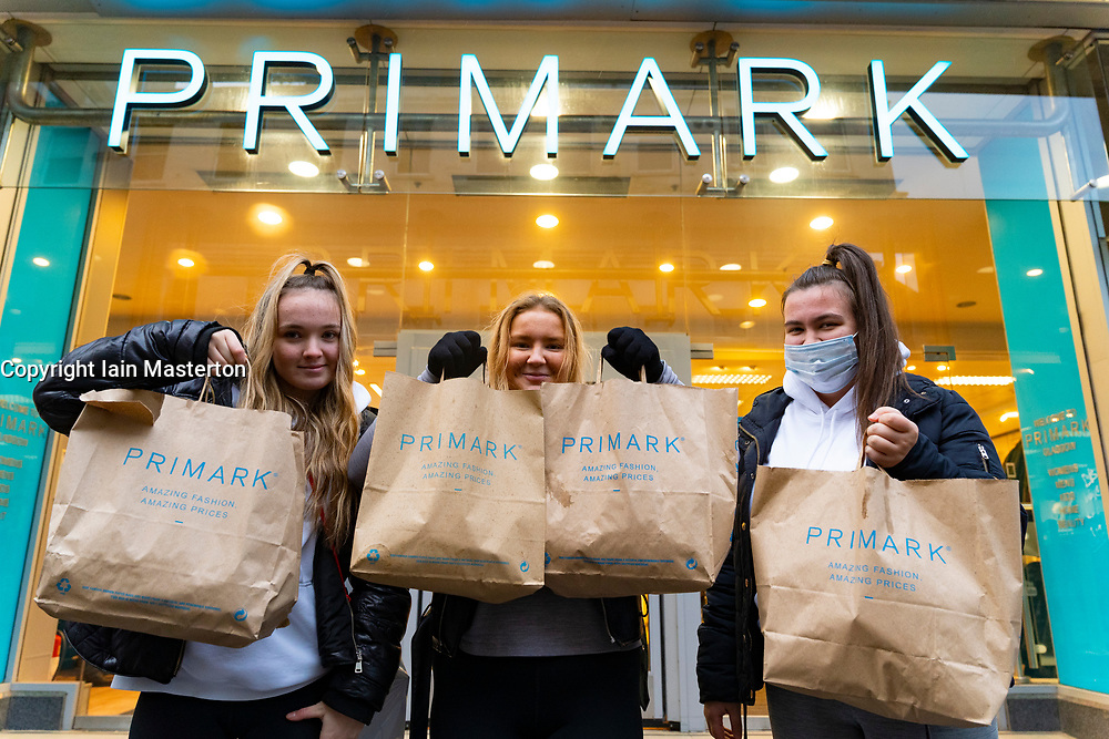 Glasgow, Scotland, UK. 11 December 2020. Covid-19 lockdown level 4 restrictions are lifted in Glasgow. Non essential businesses and restaurants can reopen from today. Pictured ; Three young  female shoppers from Cambuslang made an early visit to Primark on Argyle Street to start their Christmas shopping.   Iain Masterton/Alamy Live News