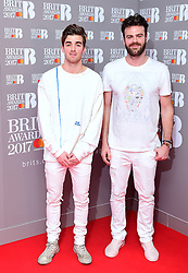 Drew Taggart and Alex Pall (right) of The Chainsmokers in the press room during the Brit Awards at the O2 Arena, London.
