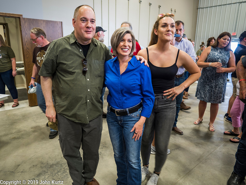 """15 JUNE 2019 - BOONE, IOWA: US Senator JONI ERNST (R-IA) poses for a selfie at """"Joni's Roast and Ride,"""" a motorcycle ride / fund raiser hosted by Ernst. Ernst, Iowa's junior US Senator, kicked off her re-election campaign during the """"Roast and Ride"""", an annual fund raiser and campaign event has she held since originally being elected to the US Senate in 2014.    PHOTO BY JACK KURTZ"""